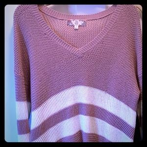 It's and comfy oversized mauve sweater